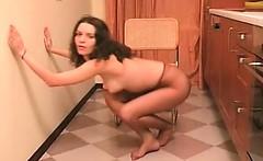 Attractive brunette stripping