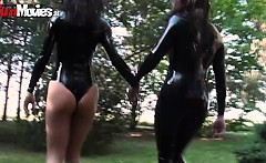 Sexy latex hoties fondling each other in the woods