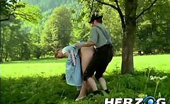 Fucking hard a big tits blonde babe under the tree