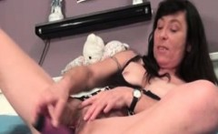 Sexy dark haired granny rubs her hairy