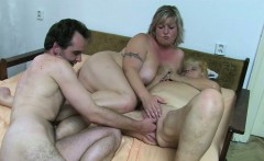 Two fat lesbians masturbate and use toys in bed