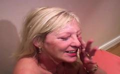 A mature blonde older woman being cummed over her face