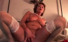 Mature blonde in stockings fingering herself
