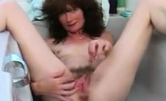 Hairy Woman Playing In The Bath Tub