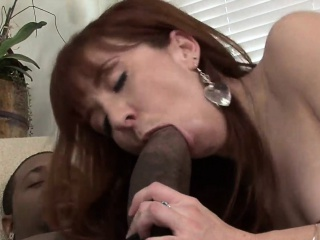 Sexy redhead swallows black dick