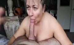 Busty mature wife sucks a big fat cock on her knees
