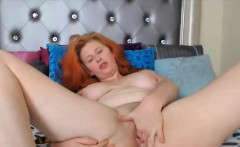 Ginger with squirting breasts and hairy pussy