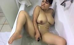 latina masturbates in the bath tub