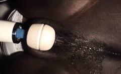 Black MILF masturbates with a vibrator.