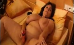 Plumper with tits masturbates together with her snatch that