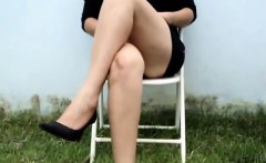 Married lady sits on a chair and displays her sexy legs for