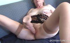 Mature masturbating with dildo