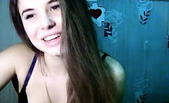 sexy little brunette is on her live webcam chatting and sho