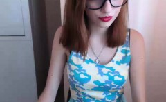 Sultry redhead teen with glasses flashes her sweet ass on t