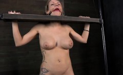 Beauty gets her cunt pleasured while inside a cage