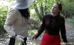 Lesbo clothed sluts get wet in the river