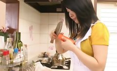 Asian hottie having fun in the kitchen