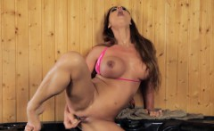 busty domina toying her pussy until she cums
