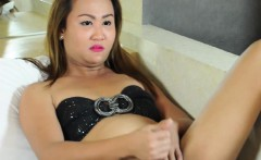 Asian ladyboy tugging on her cock