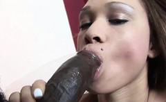 Petite hussy rides on a massive dong
