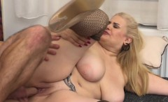 Big breasted lady doing her toyboy