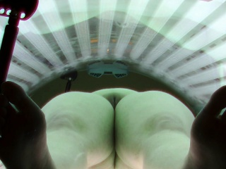 Busty Chubby Girl Relaxing in Solarium Tanning Bed