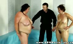 Huge BBW wins wrestling match and she grabs referees hard