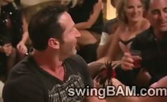 Several swinger couples try to live together all in the