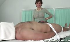 Domina lends him a hand with his hard dick during his