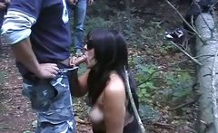 Mature amateur gets on her knees in the forest and gives