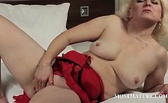 Mature blonde finger fucks lusty twat