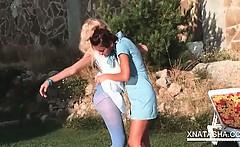 Outdoor lesbian scene with Natasha Shy rubbing pussy