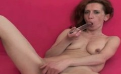 Slim old granny masturbates with red dildo