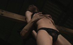 Blonde slave trapped in a dark fetish punishment
