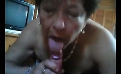 Old Lady woman sucks hairy man lying on the bed at home