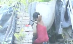 Poor Woman Washing Her Body Outdoors