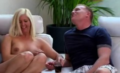 Blondie sucks off in the middle of a swingers party