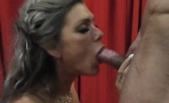 Busty MILF fucks with strong guy and gets a big facial