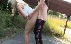 Horny wild blonde sucking and fucking her man by the road