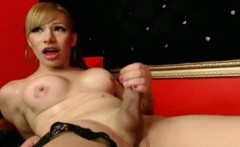 Transsexual covers her body with her own cum