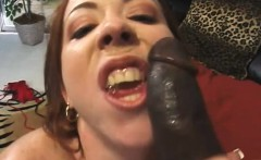 Enticing redhead with lovely titties feeds her passion for black meat