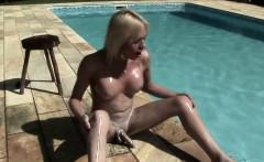 Beautiful shegirl enjoys hardcore masturbation by the pool