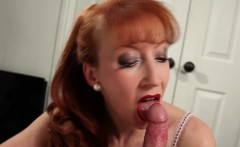 Busty redhead MILF Red wanks her mans cock before riding it