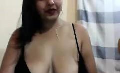 Brunette chick with big boobs sticks huge dildo up her vag