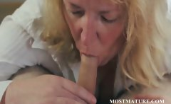 Blonde MILF gives hand and boob job
