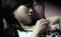 Asian babe watched toying