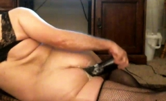 Naked granny playing and toying with sex toys