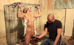 Girl in a cage gets punished