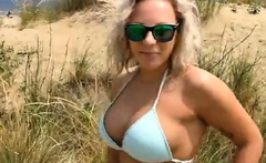 Big breasted blonde milf sucking and fucking on the beach