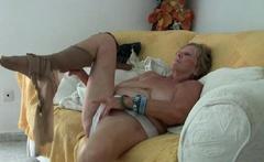 Big titted granny Deborah dildos her old pussy in bathtub